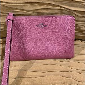 Rose pink Coach wristlet